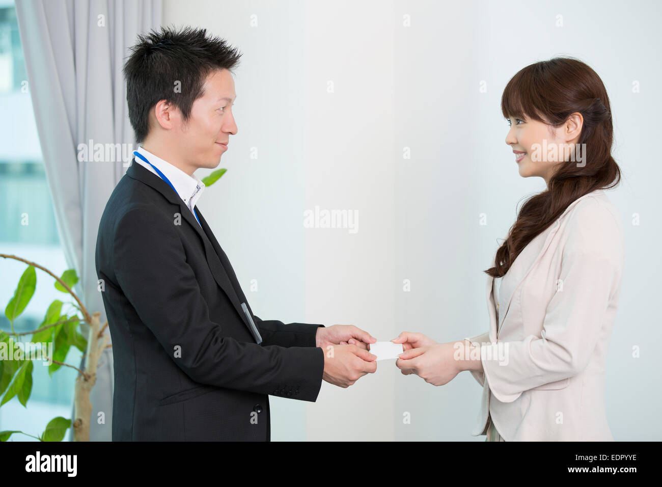 Business People Exchanging Business Cards - Stock Image