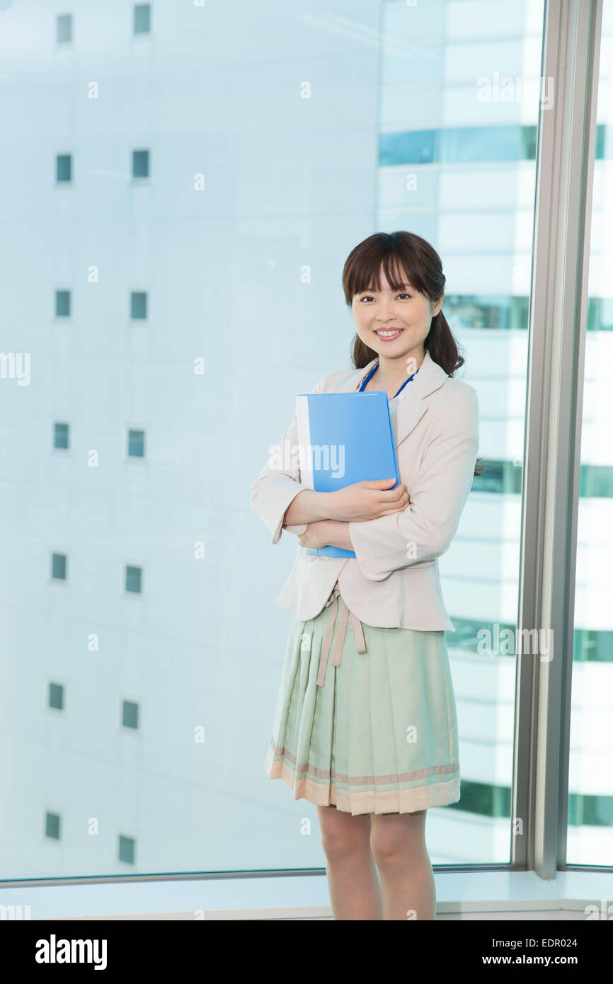 Businesswoman Standing and Holding Folder - Stock Image