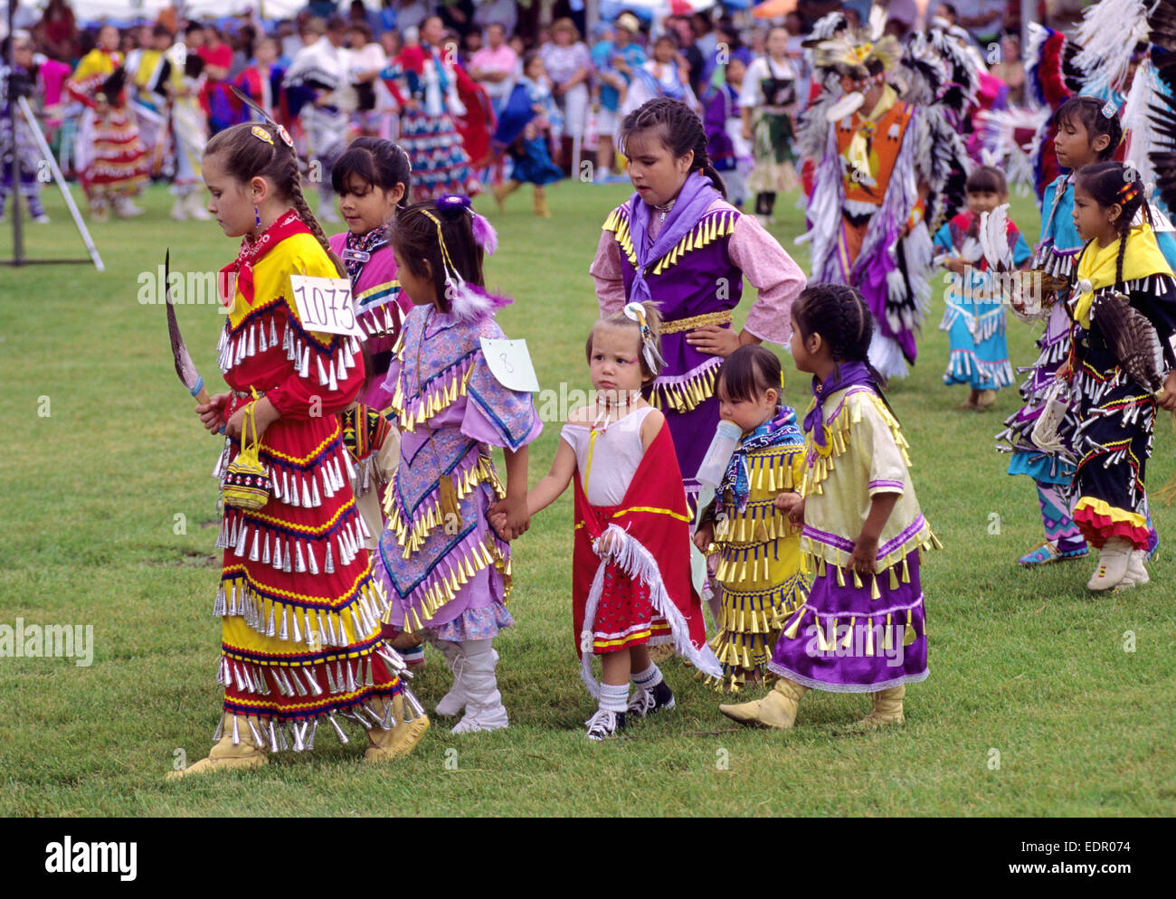Young girls in jingle dresses participating in a pow wow held on Manitoulin Island, Ontario, Canada. - Stock Image