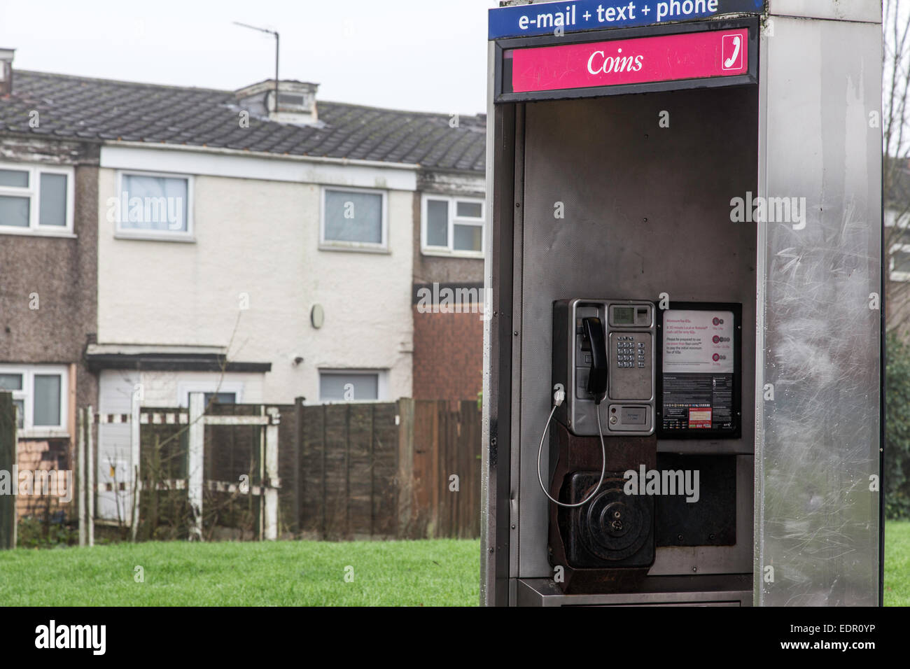 KX100 BT telephone kiosk outside a housing estate, England, UK - Stock Image