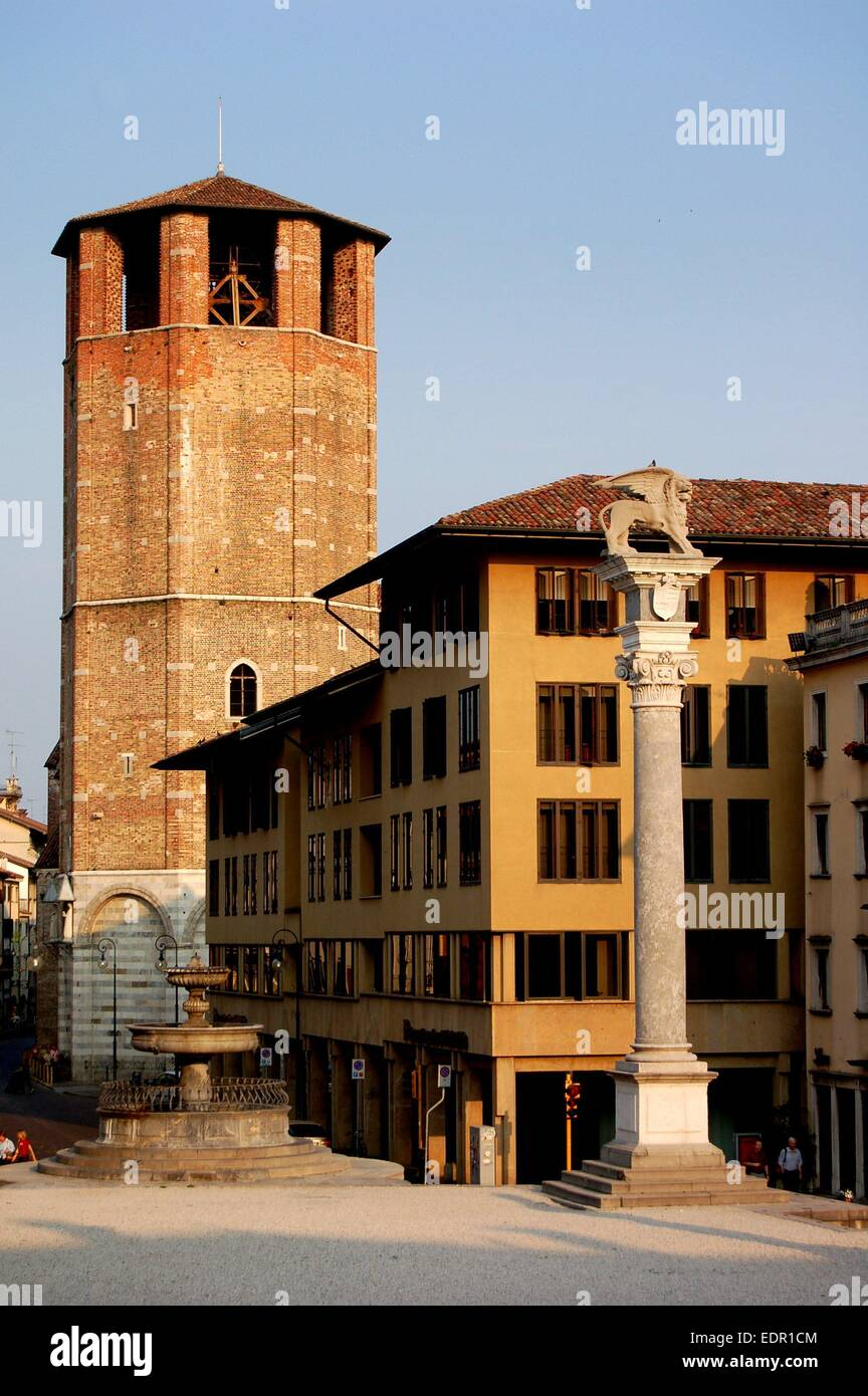 UDINE, ITALY:  The Lion of Venice column (right) in the Piazza della Liberta and the 14th century Campanile of the - Stock Image