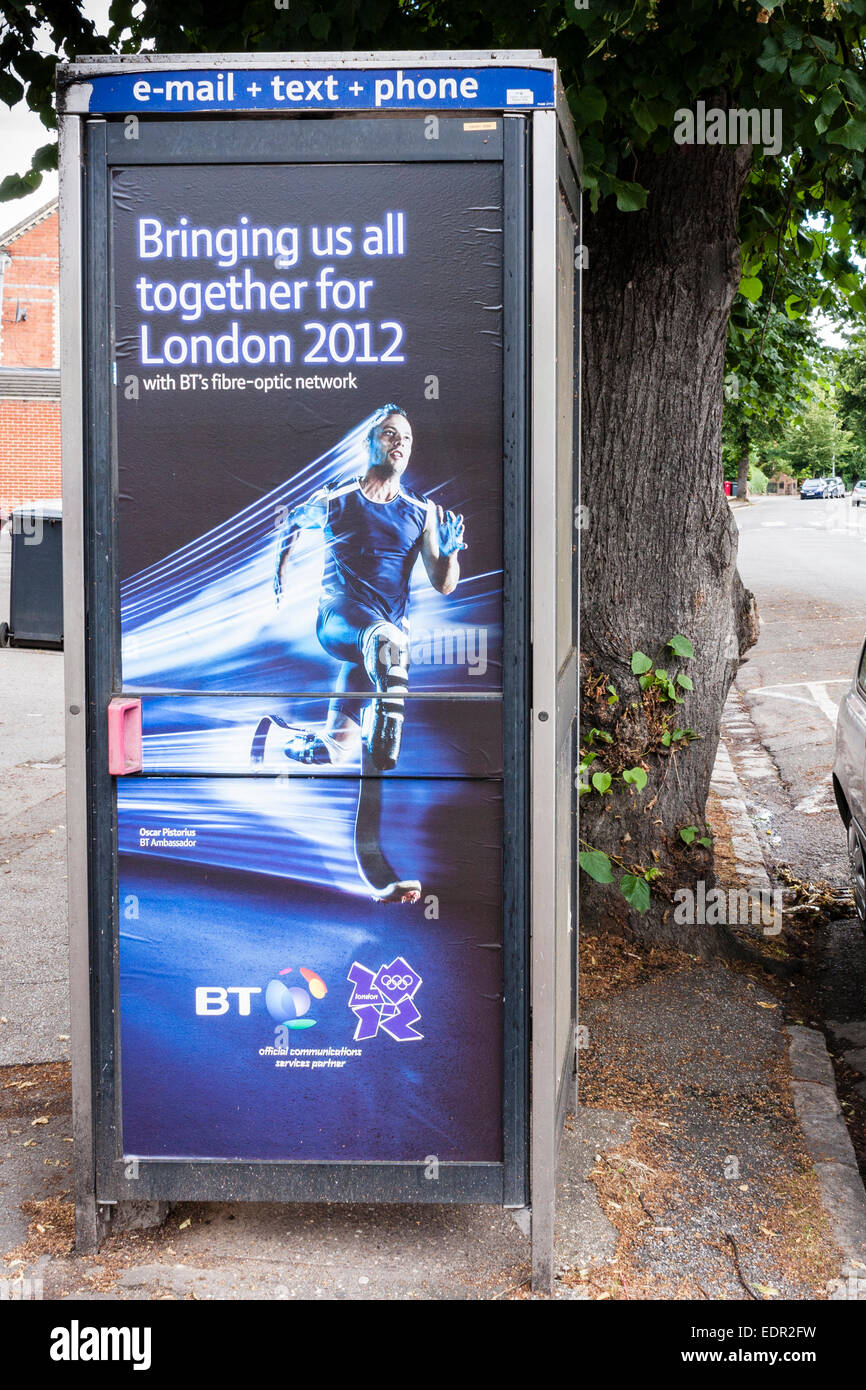 British Telecom callbox with London 2012 Olympics advert on side - Stock Image