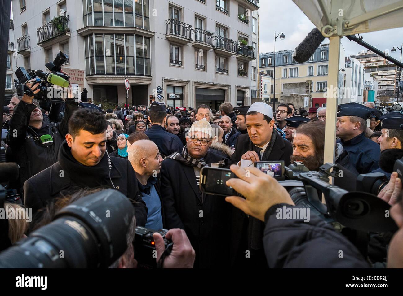 Paris, France. 8th Jan, 2015. Hassen Chalghoumi, imam of Drancy mosque (white hat) and Marek Halter, Jewish writer, Stock Photo