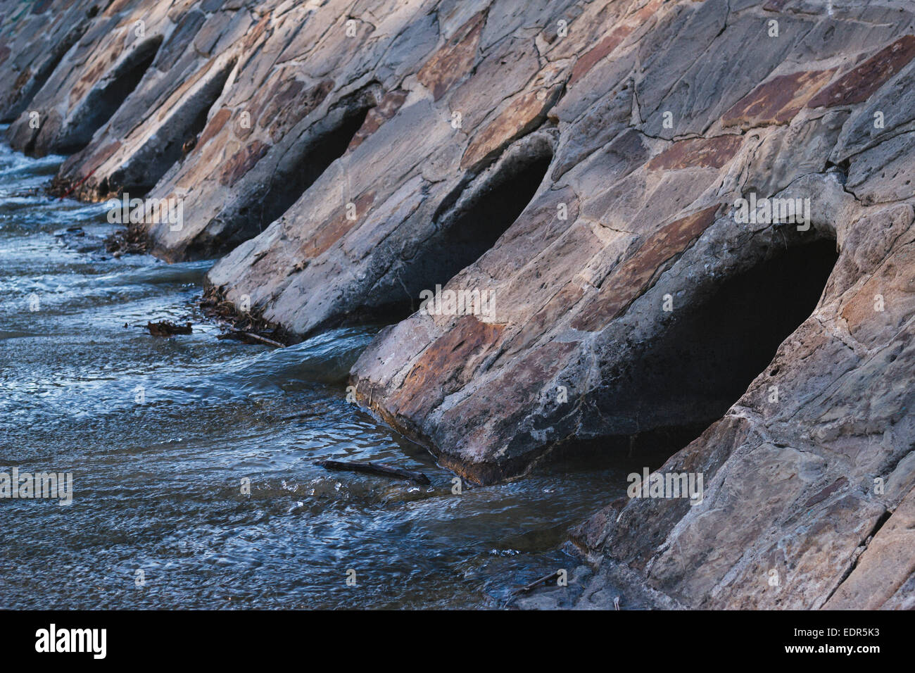 a series of drains for water - Stock Image