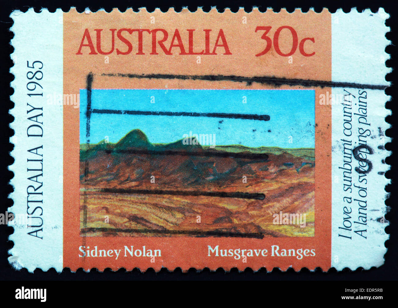Used and postmarked Australia / Austrailian Stamp 30c day 1985 Sidney Nolan Musgrave Ranges Stock Photo