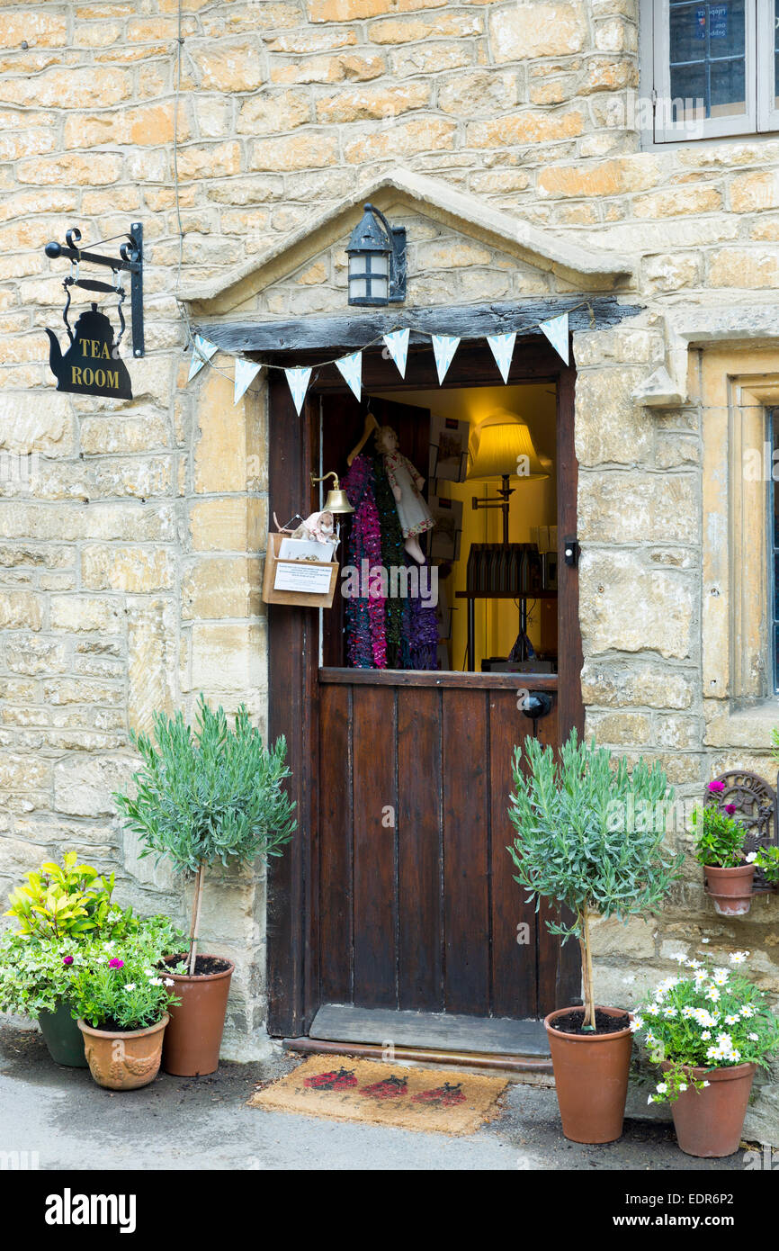 Traditional English tearoom with stable door half open in the quaint village of Castle Combe in Wiltshire, The Cotswolds, - Stock Image