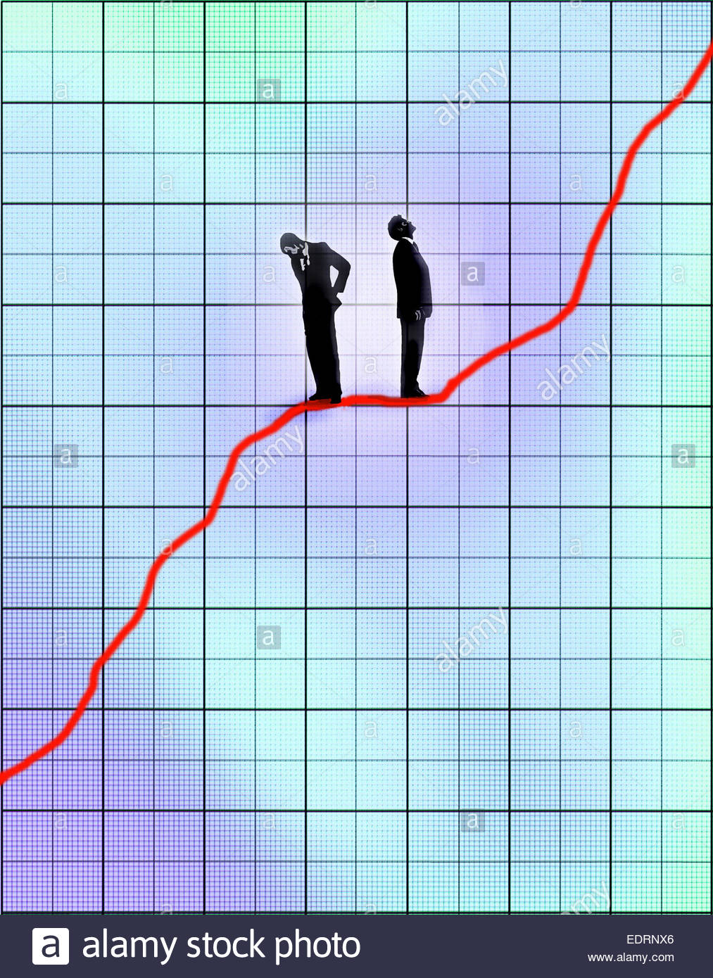 Contrasting businessmen standing on line graph chart optimist looking up and pessimist looking down - Stock Image