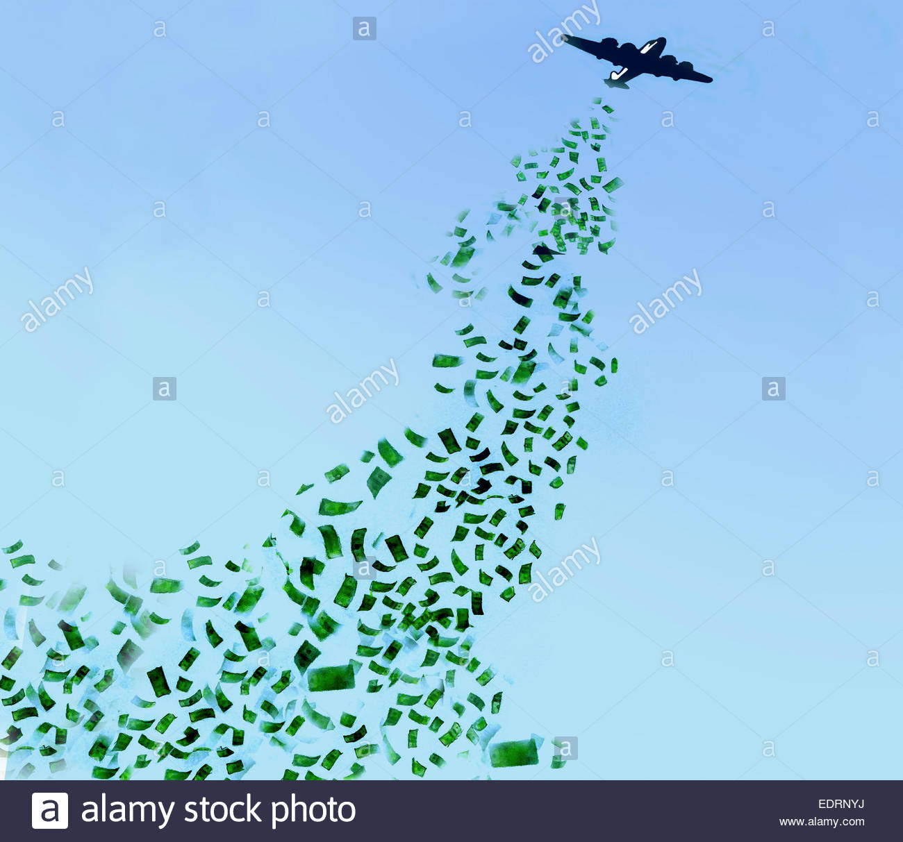 Money falling from flying airplane - Stock Image