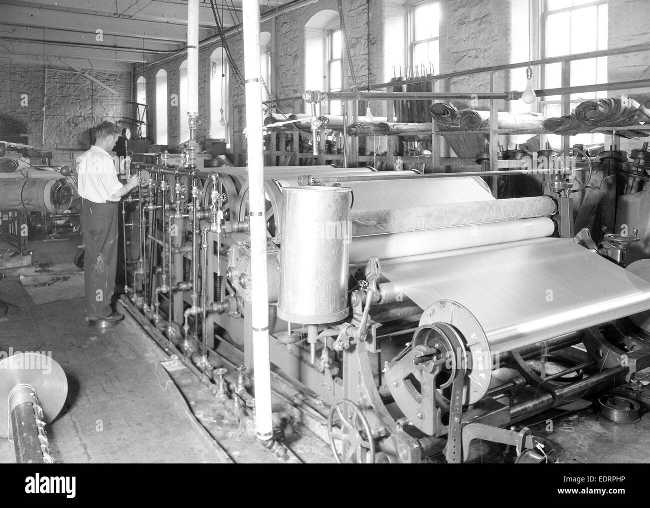 Paterson, New Jersey - Textiles. [Man working at machines.], 1936, Lewis Hine, 1874 - 1940, was an American photographer Stock Photo
