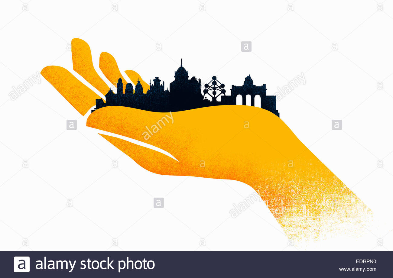 Hand holding skyline of European urban architecture - Stock Image
