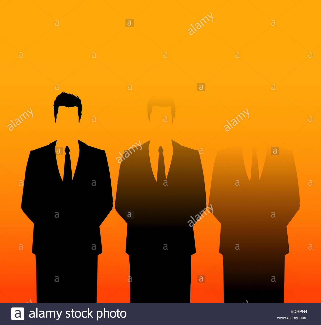 Businessman standing out from the crowd with co-workers fading - Stock Image