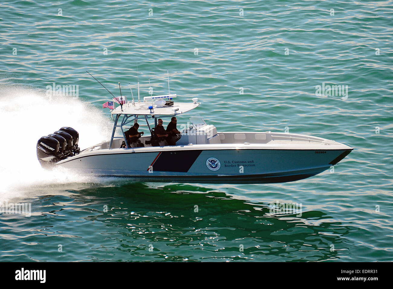 "US Customs and Border Protection Marine unit operating a 1200HP 39' Midnight Express Boat, the ""the most powerful - Stock Image"