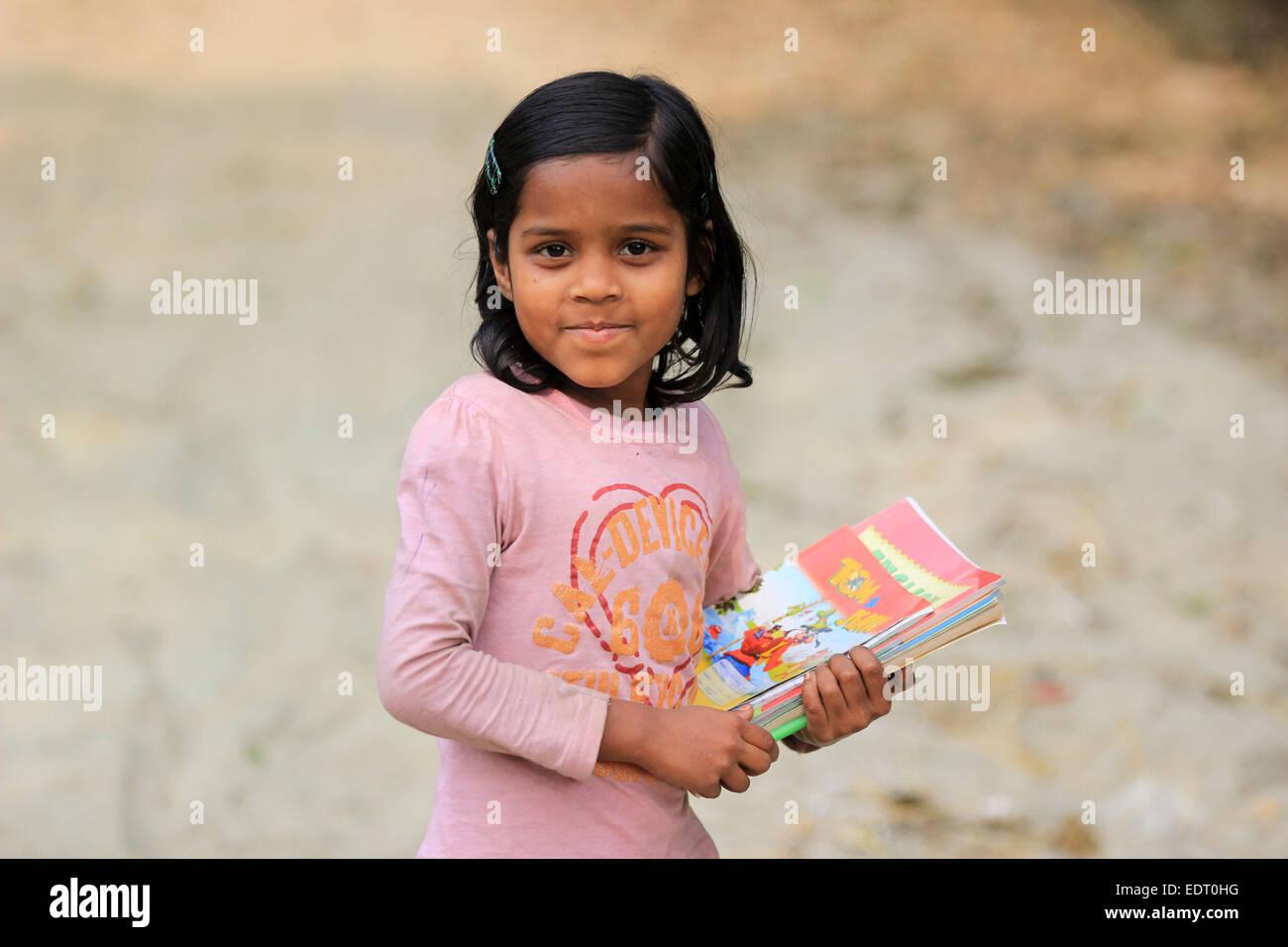 January 2015. School-girl with book in dhaka. Stock Photo