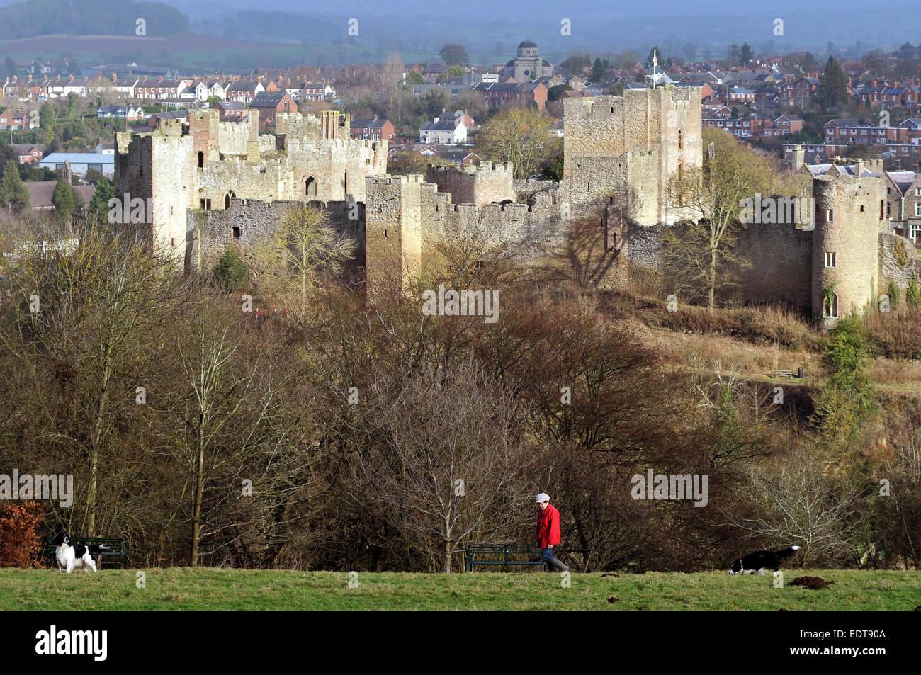 Ludlow, Shropshire, UK. 9th January, 2015. Unusually warm seasonal weather in Ludlow, Shropshire UK. A woman walks - Stock Image