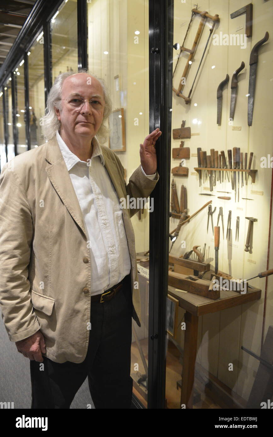 Author Philip Pullman with traditional woodworking tools at the Pitt Rivers Museum, Oxford - Stock Image