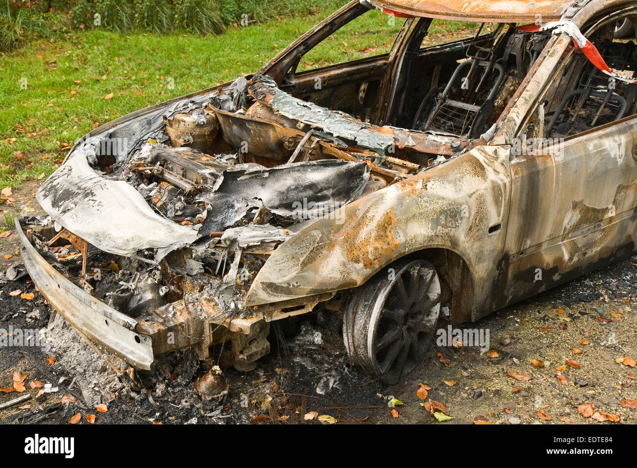Getaway car destroyed by a fire - Stock Image