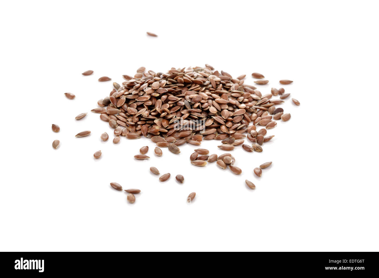 Pile of brown flax seeds isolated on white background. Flax seeds are rich in omega-3 fatty acid. - Stock Image