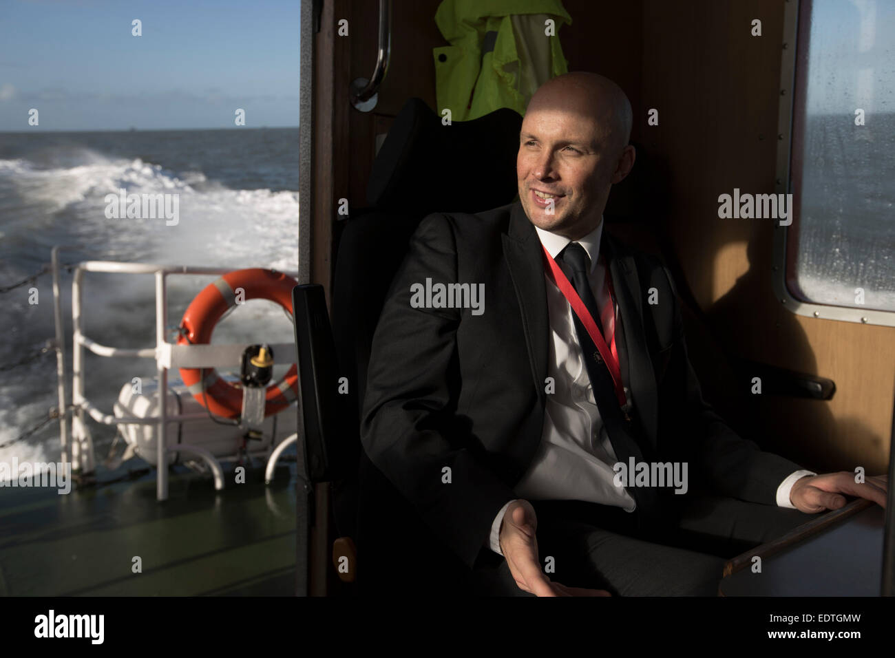 James Smart one of the team of Liverpool pilots employed by Liverpool Pilot Services Ltd on the river Mersey, England, - Stock Image