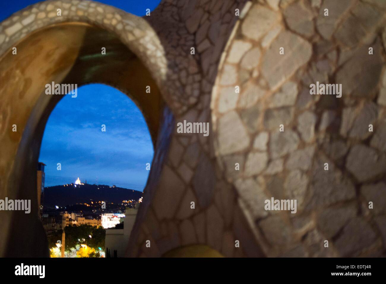 Casa Mila, La Pedrera, skyline of Barcelona, Spain. The chimneys. Panorama of the roof at dusk, evening, night. - Stock Image