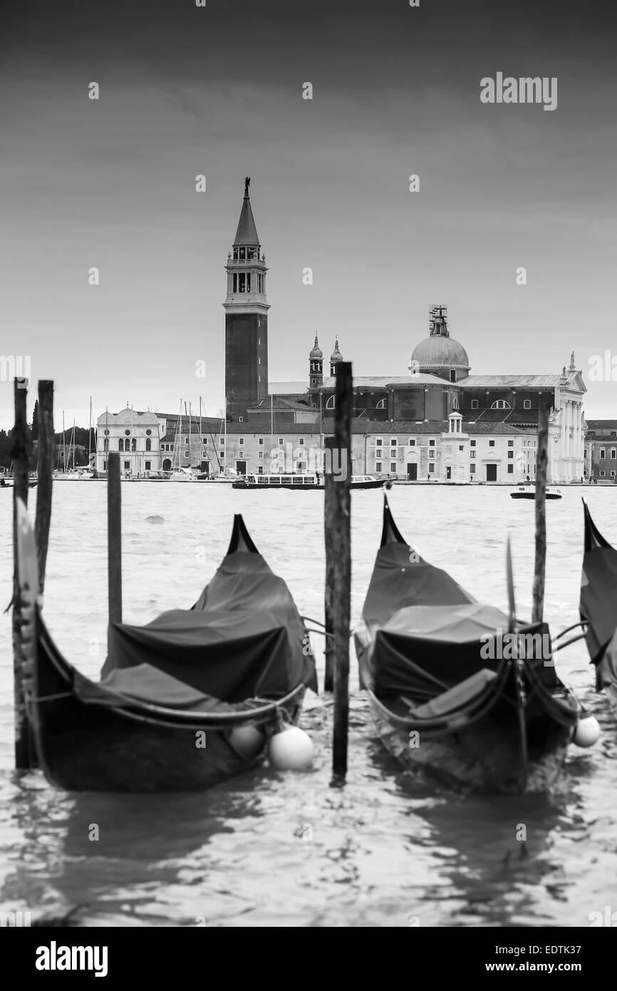Church of San Giorgio Maggiore on the island of the San Giorgio Maggiore with gondolas parked in the water in Venice, - Stock Image