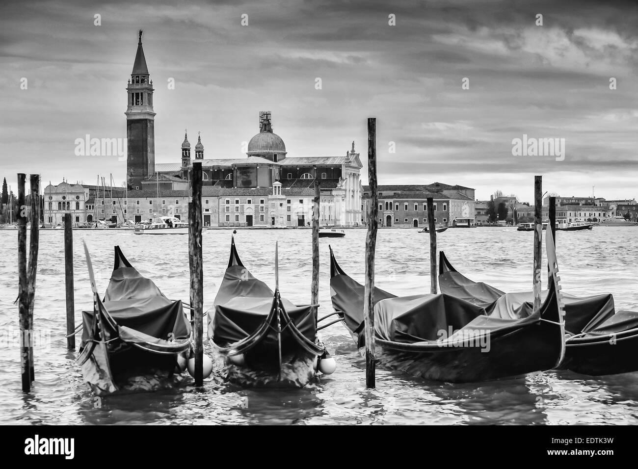 Church of San Giorgio Maggiore on the island of the San Giorgio Maggiore with gondolas parked in the water in Venice, Stock Photo