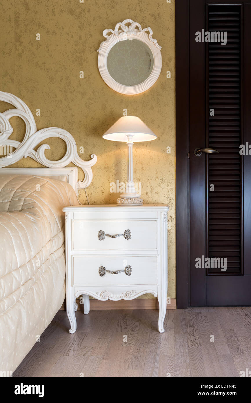 White Vintage Style Nightstand With A Lamp In A Bedroom Stock Photo Alamy