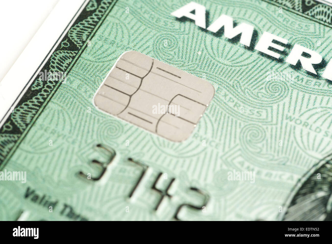 Close-up of American Express card showing integrated circuit card (ICC) chip - Stock Image