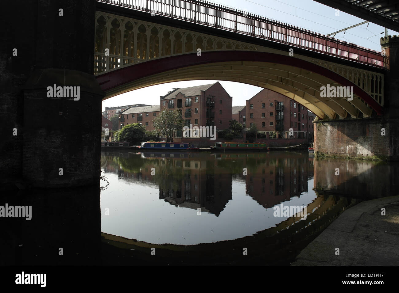 Sunny view, to Castlefield Junction, cast iron arch Manchester South Junction Viaduct crossing Castlefield Basin, Stock Photo
