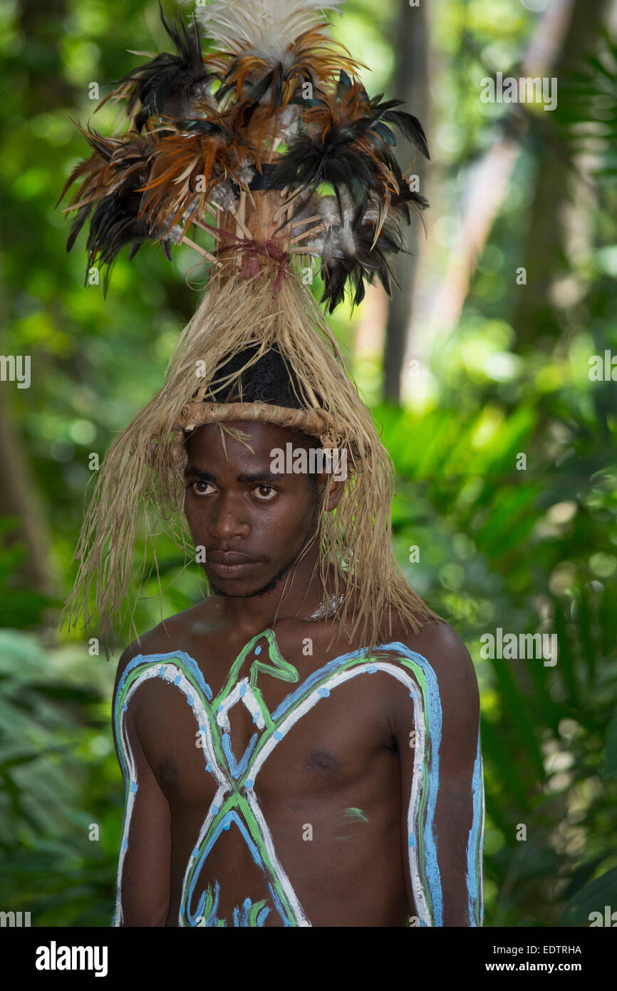 Melanesia, Vanuatu, Rano Island. Traditional welcome ceremony. Village man wearing feather headdress and body paint. - Stock Image