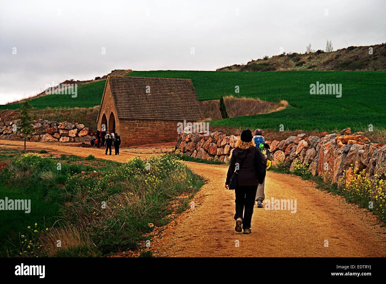 Pilgrims walking on the Camino de Santiago de Compostela. Way of Saint James pilgrimage - Stock Image