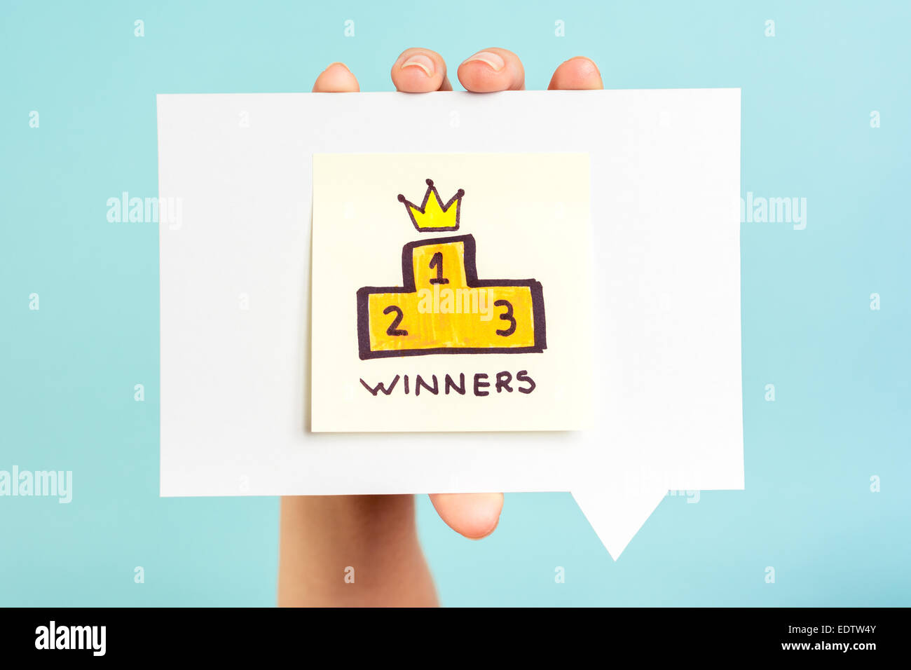 Winners podium message on blue background - Stock Image