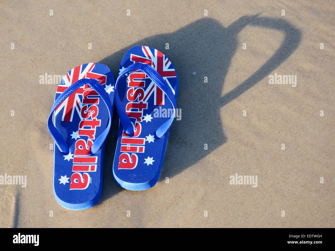 7bc8c3c273a6 Australian sandals flip flops thongs with Australian flag on wide sandy  beach in early morning sun. Taken in South Australia.