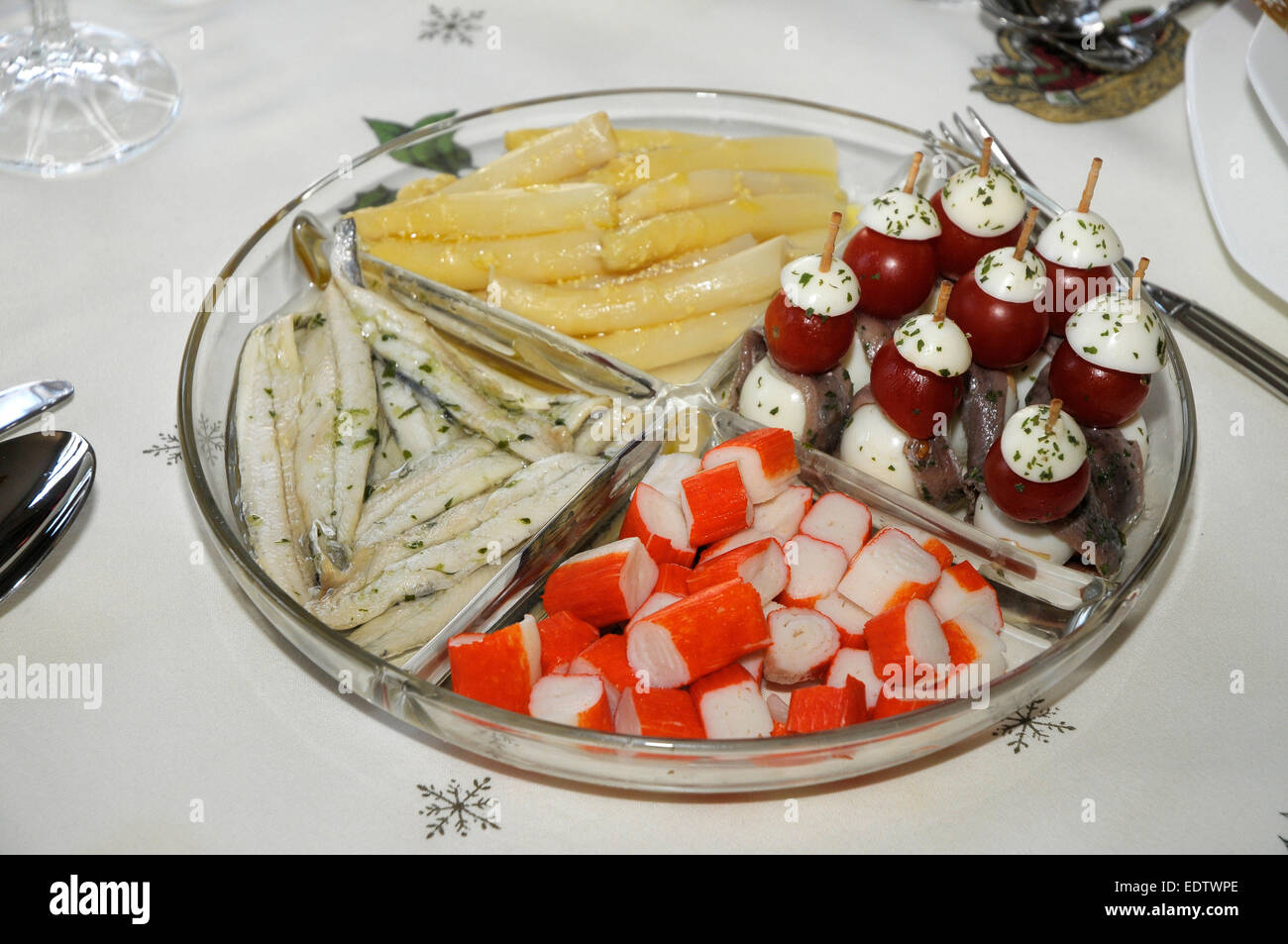 asparagus, anchovies, tomato, cheese and egg, crab served together as a snack bar - Stock Image