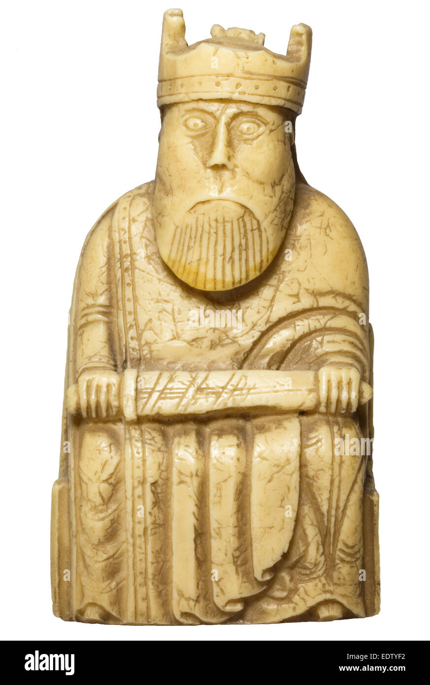 Cut out of 12th century Lewis chessmen piece - king holding sword - Stock Image