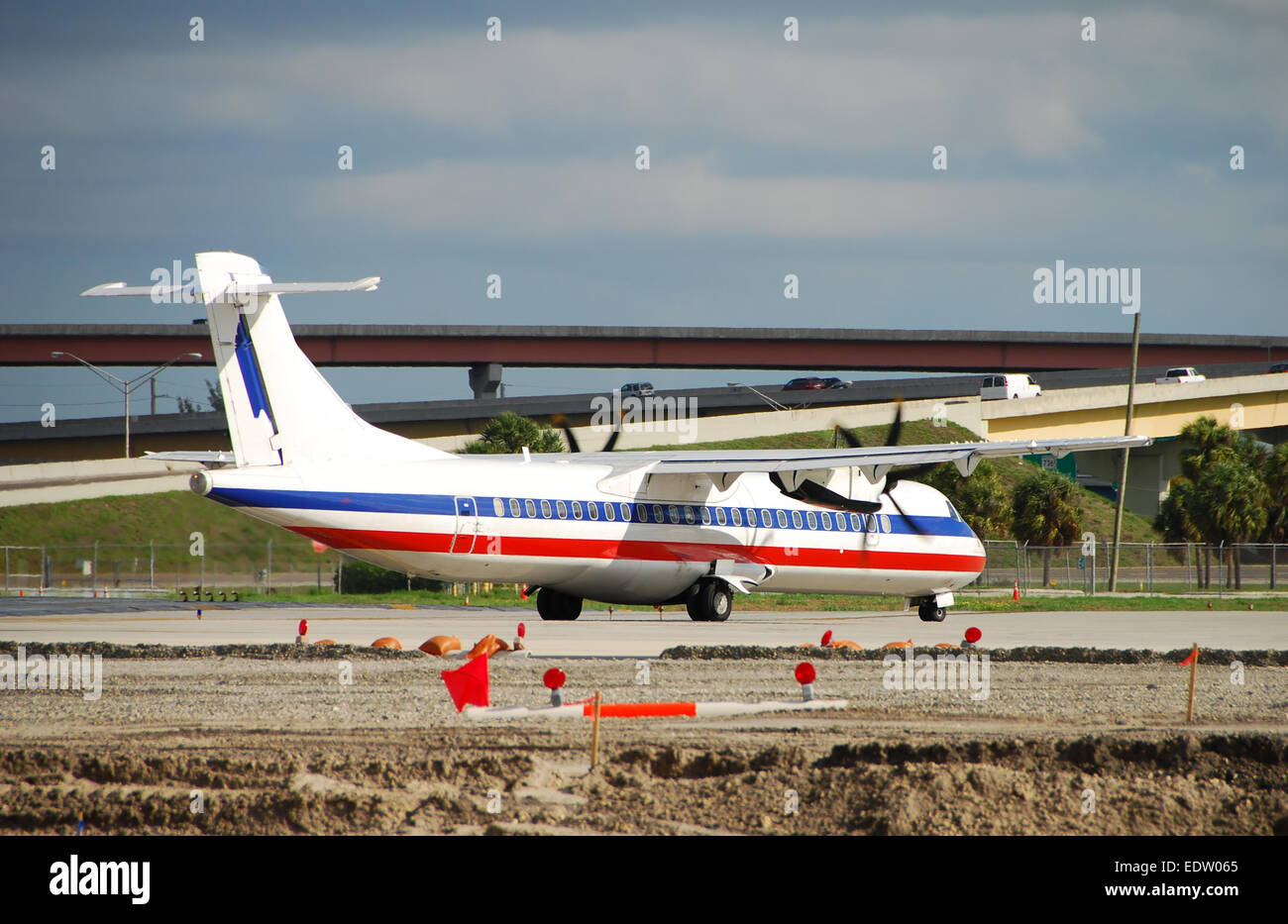 Turboprop airplane ATR-72 preparing for takeoff - Stock Image