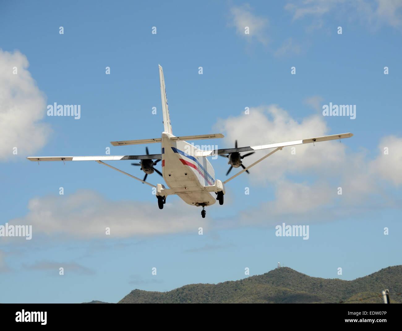 Turboprop airplane landing rear view - Stock Image