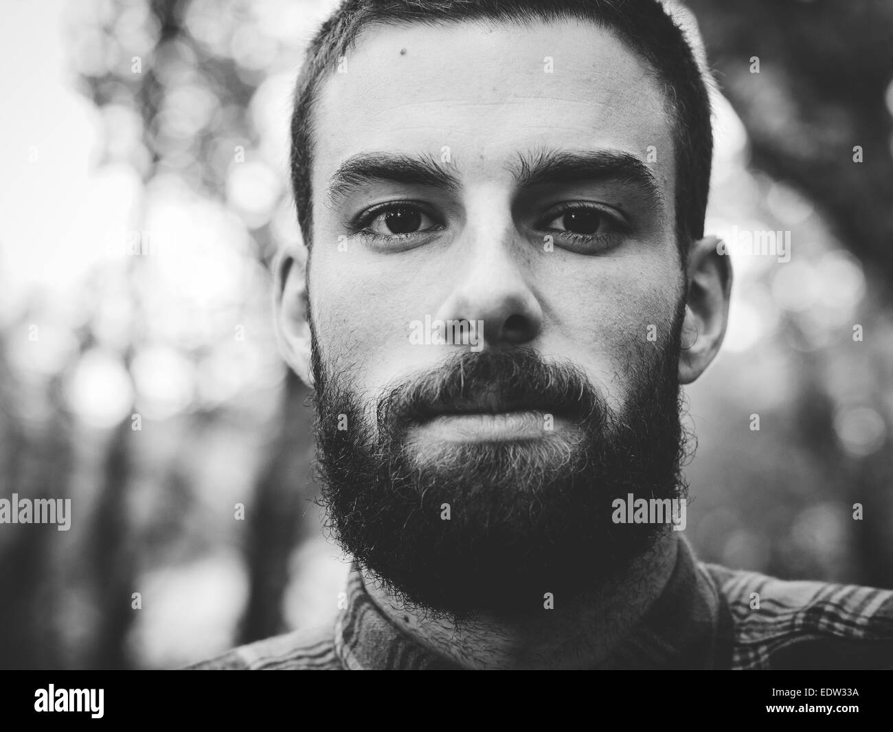 Hipster man portrait  in black and white in horizontal composition. - Stock Image