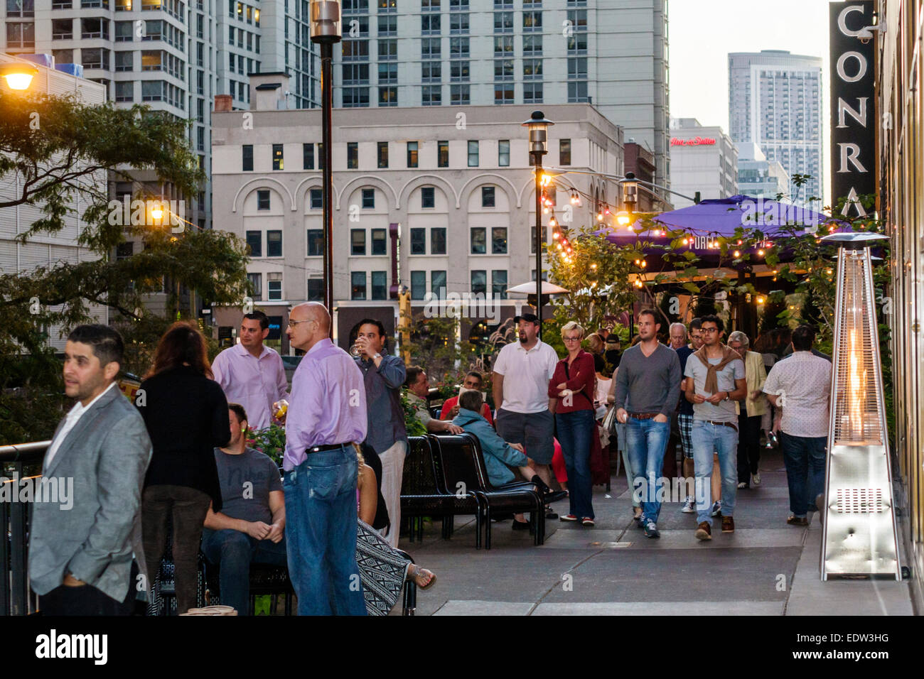 Chicago Illinois North River Michigan Avenue Magnificent Mile The Purple Pig restaurant entrance customers evening - Stock Image