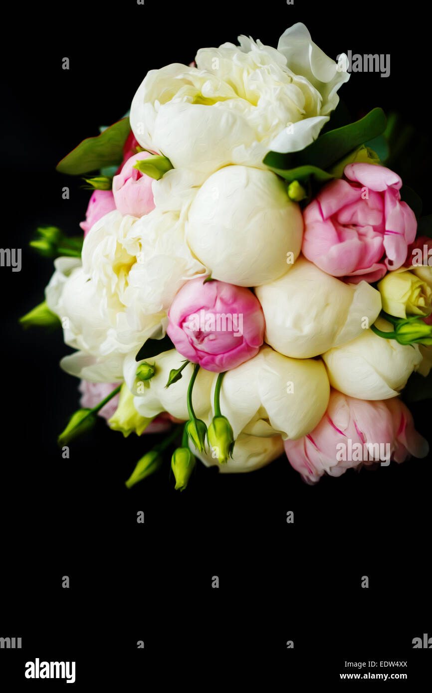 Wedding bouquet of ranunculus and peony flowers on black background ...