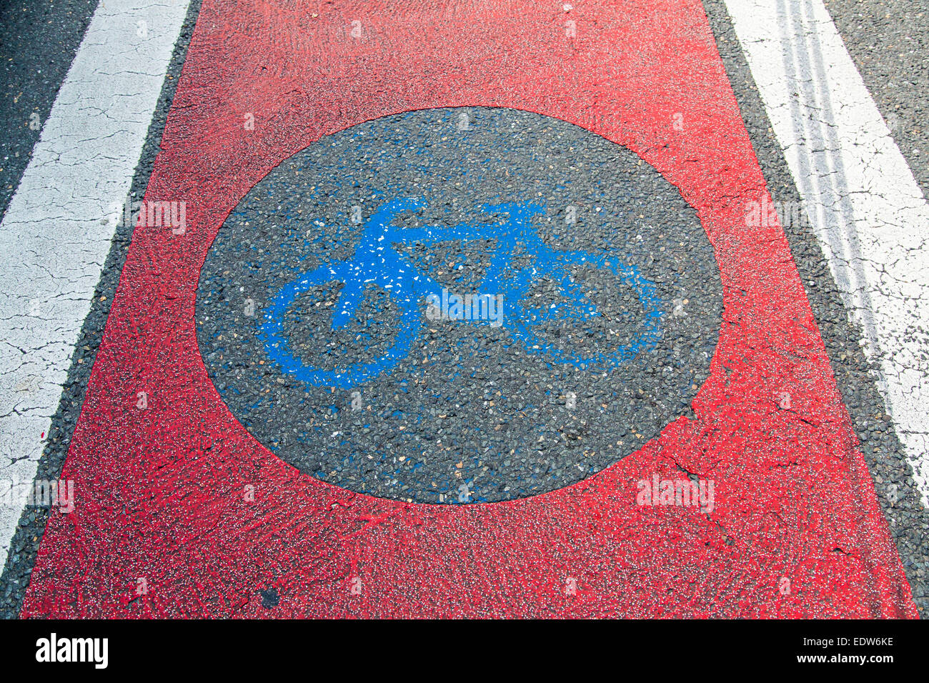 Traffic signs for bike path, painted on the pavement, worn, Stock Photo