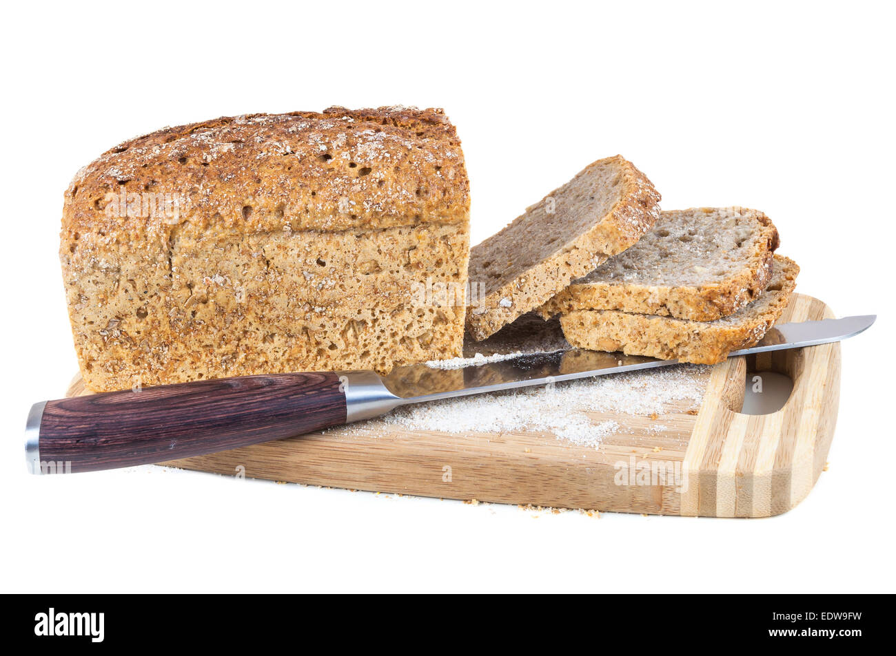 Cut Wholemeal Bread And Knife On A Chopping Board Isolated