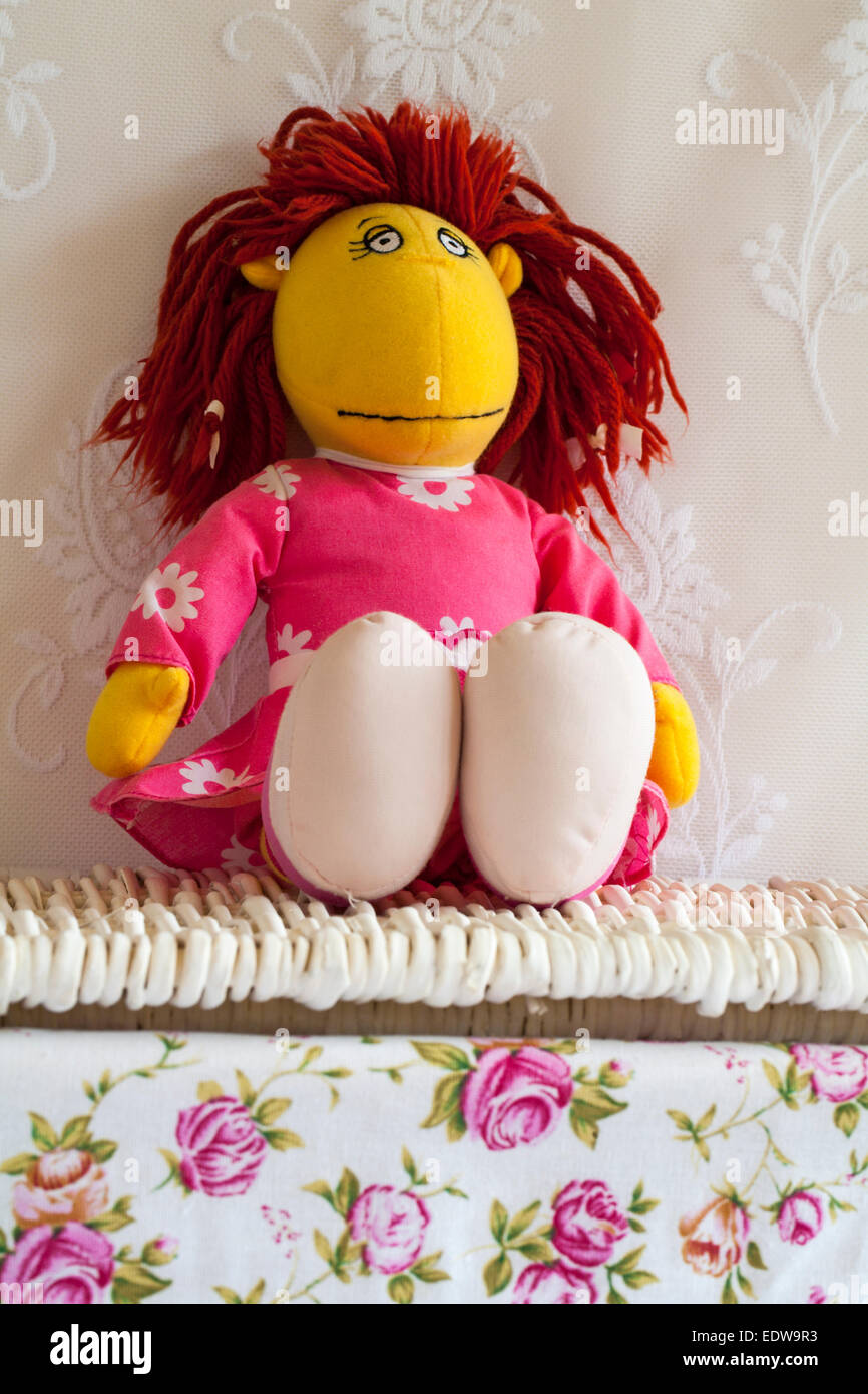 Tweenies Fizz character soft cuddly toy sitting on wicker basket - Stock Image