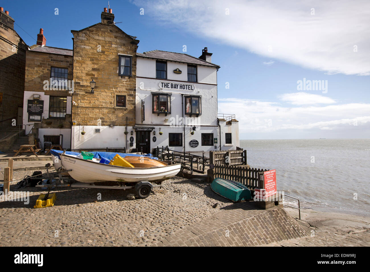 UK, England, Yorkshire, Robin Hood's Bay, Lower Village, boats outside the Bay Hotel - Stock Image