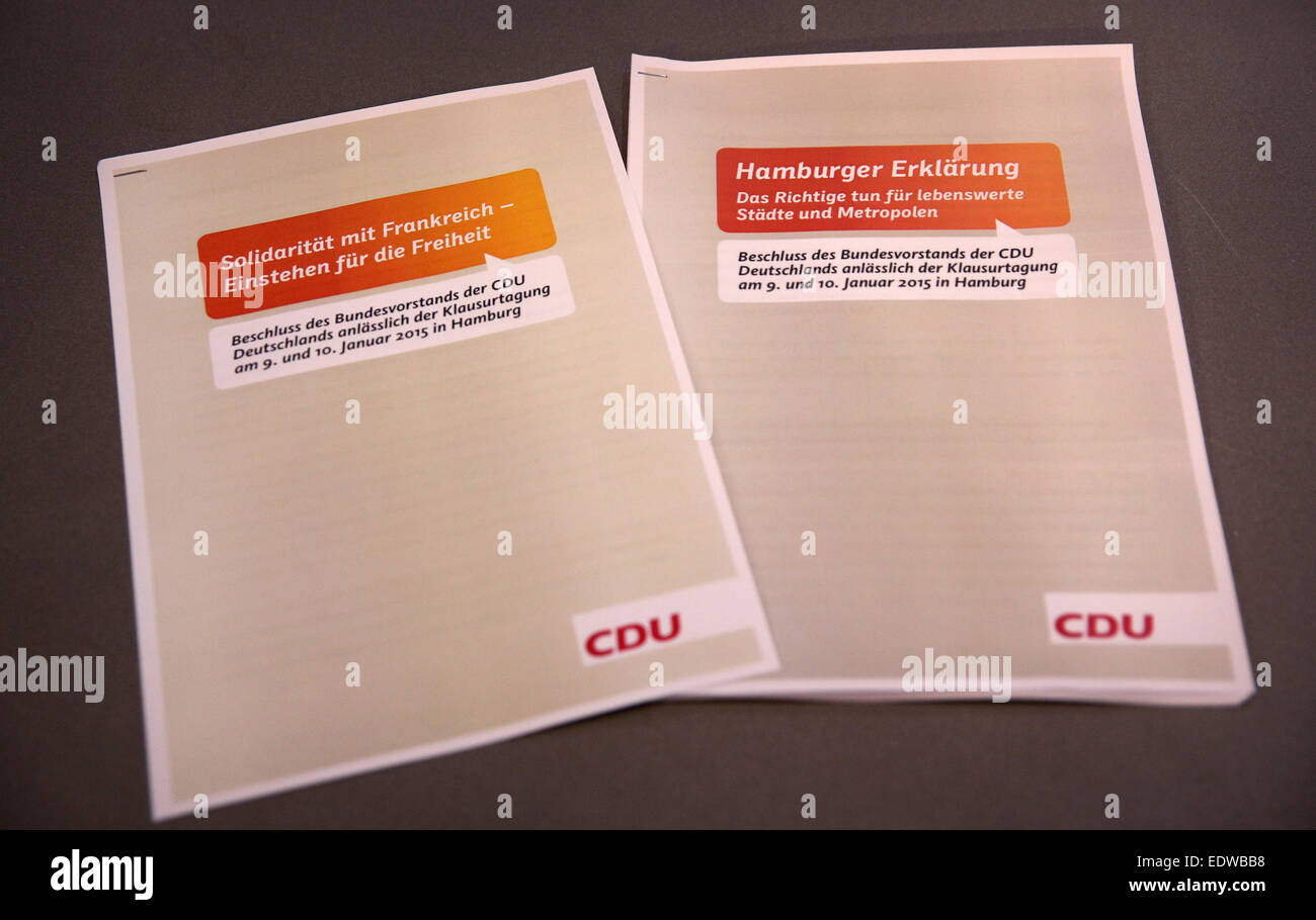 Two resolutions of the CDU federal board lie on a table during a press conference after the closed meeting of the - Stock Image