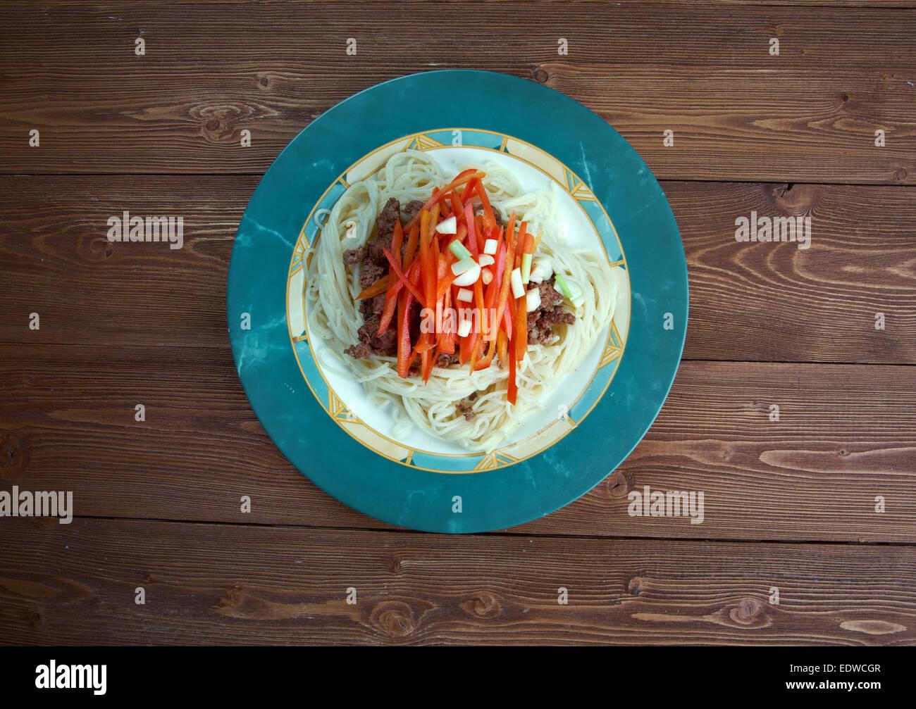 Cincinnati chili - regional style of chili con carne. ingredient chili, spaghetti, paprika , diced onions Stock Photo