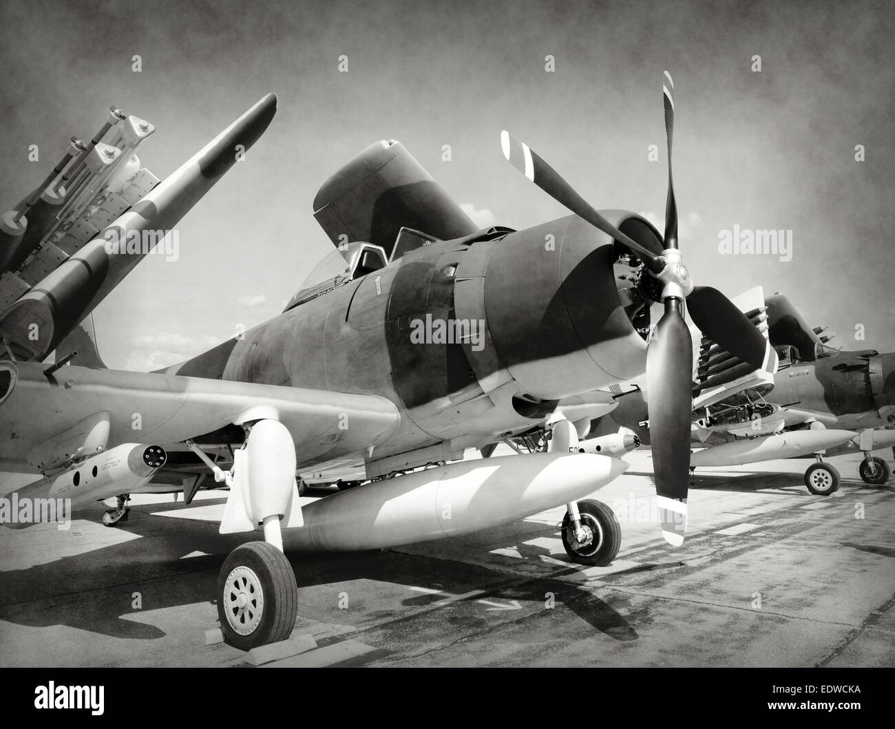 World War II era fighter planes in stained old photo - Stock Image
