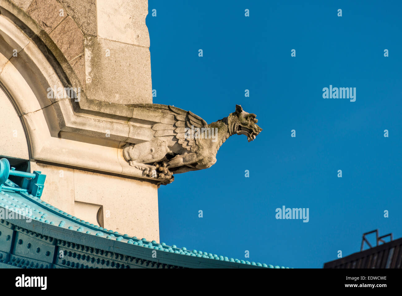 Gargoyles and grotesques adorning Tower Bridge, a suspension bridge spanning the River Thames - Stock Image