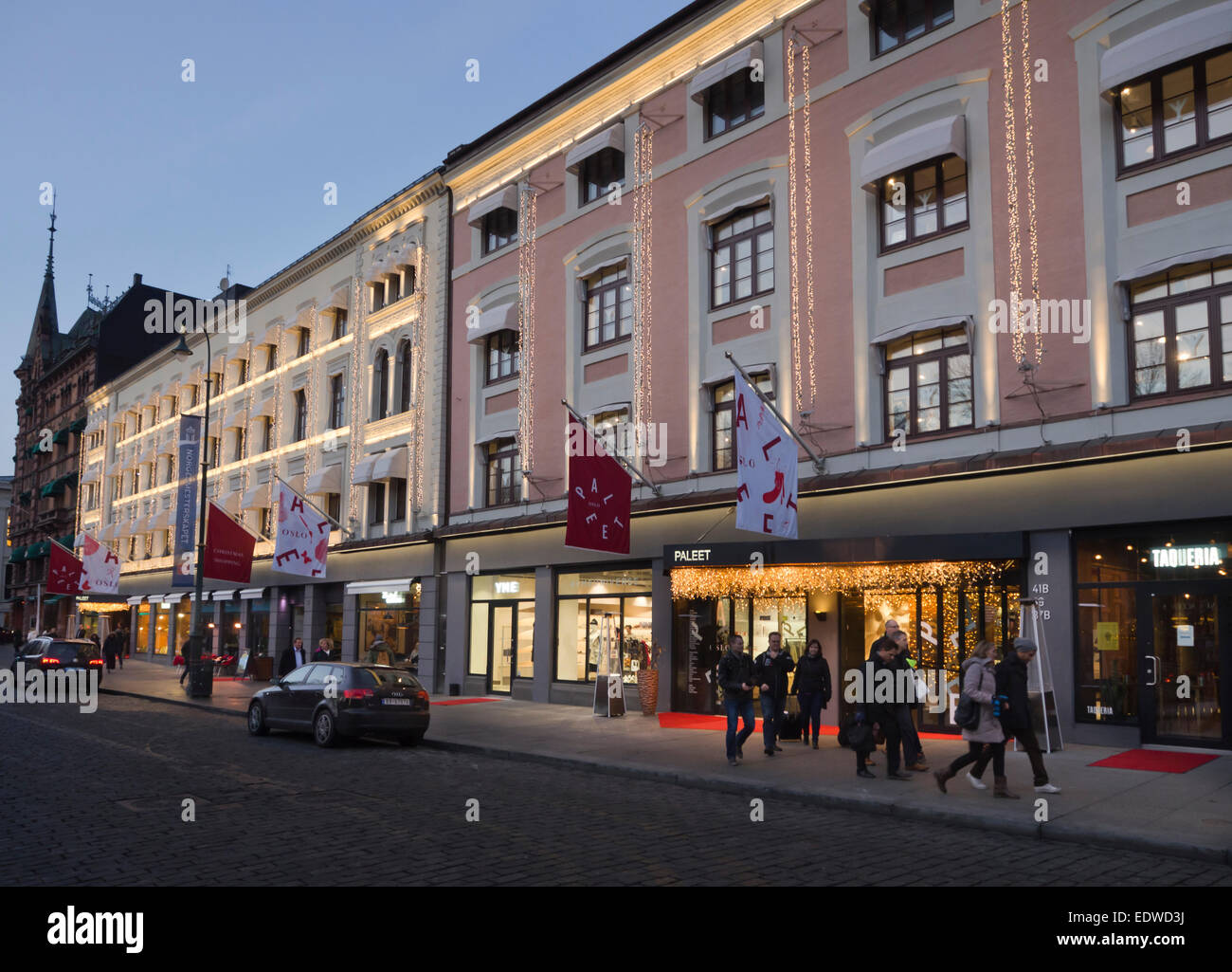 Paleet shopping center in Karl Johans gate Oslo Norway, lighting up for customers in the winter season - Stock Image