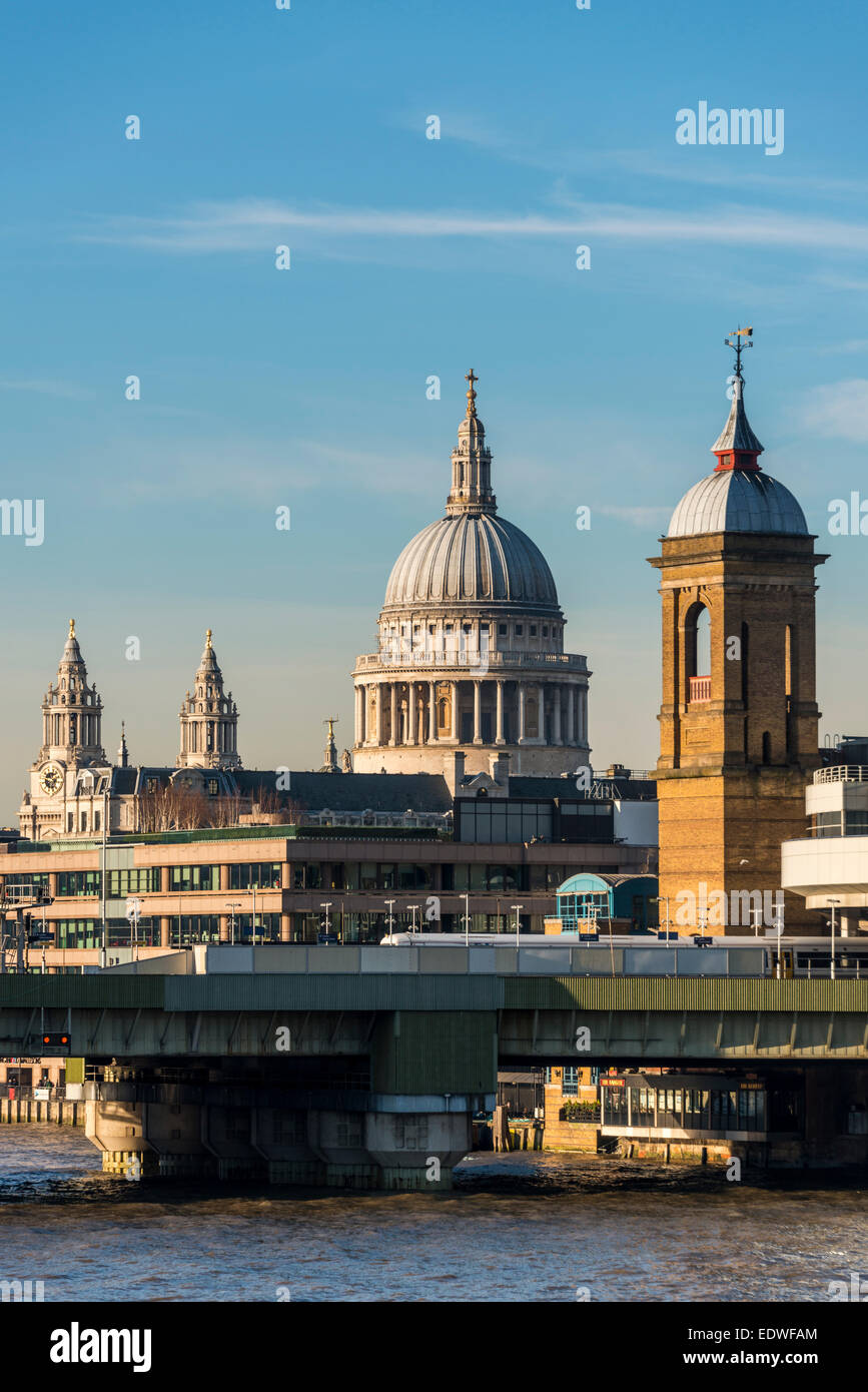 View across the River Thames to cannon Street rail station and St Paul's Cathedral - Stock Image