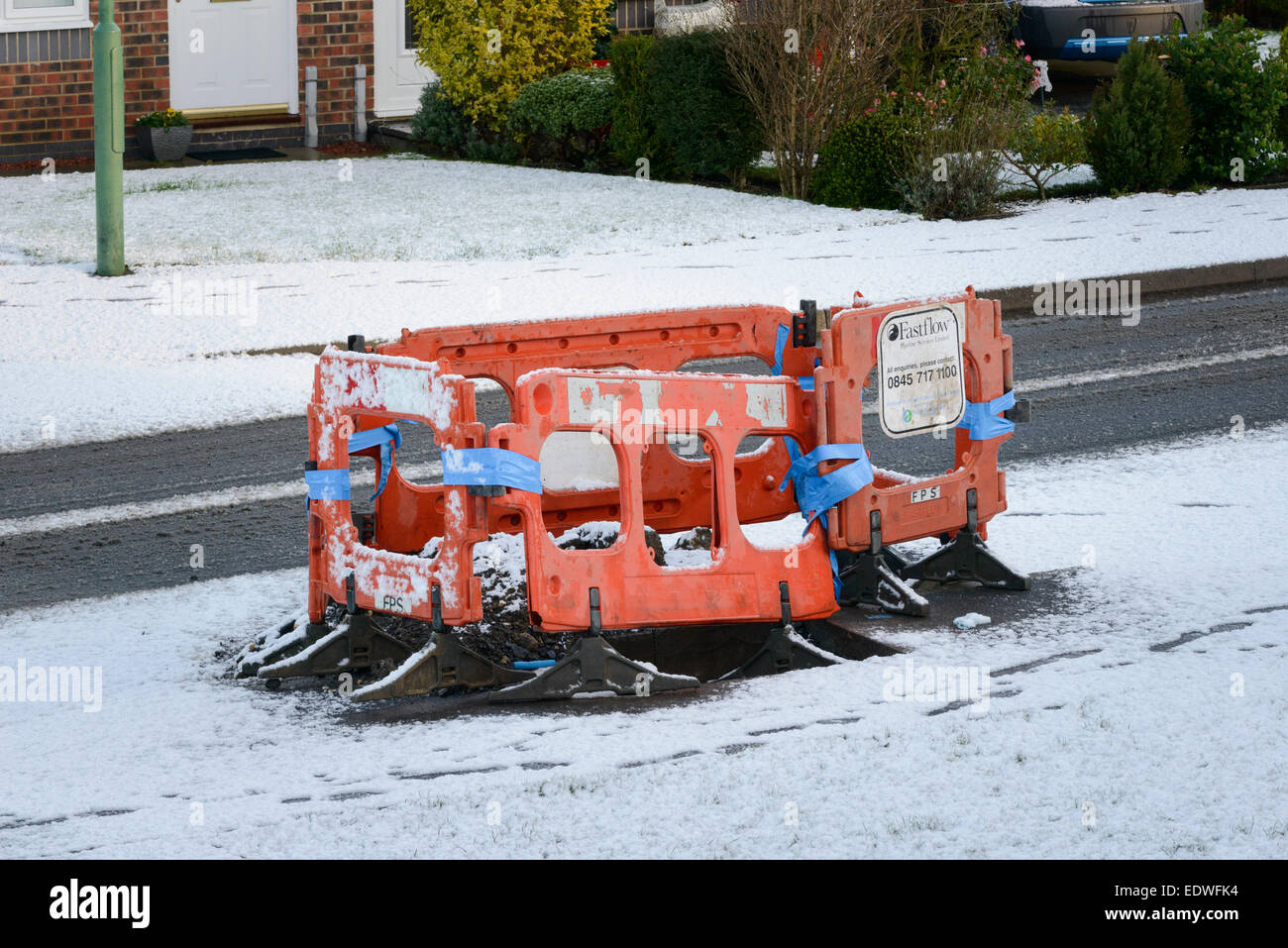 A burst water main under repair - Stock Image